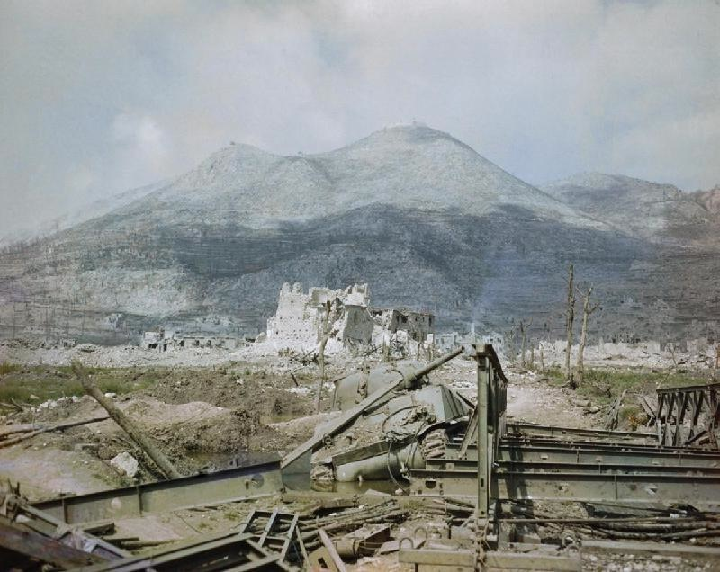 <p>Cassino, 15 maggio 1944. Le rovine della città e in primo piano uno dei ponti sul Rapido costruiti dal 48th Engineer Combat Battalion.</p><p class='eng'>... At the building of the baileys, of course at night, WE had nine dead & many many wounded. The first night of construction the first platoon of Co B went into Cassino with the Maoris. It was much quieter inside the town than at the bridge site... This is one of the baileys WE built March 15-20. They were soon destroyed by the Jerries. This is the scene the Poles saw about May 15.<br />Courtesy Marion J Chard.</p>